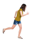 Back view of running  woman. Royalty Free Stock Photo