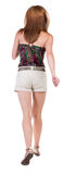 Back view of running  woman in shorts Royalty Free Stock Photos