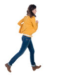 Back view of running  woman in yellow cardigan Stock Photos