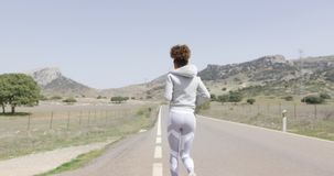 Back view of running woman stock video