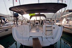 Back view sailing boat. Steer and compass on sailing boat Royalty Free Stock Photography