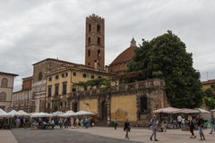 Back view of San Giovanni Church and Sunday market on Piazza San Martino. Lucca. Italy. Royalty Free Stock Photography