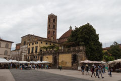 Back view of San Giovanni Church and Sunday market on Piazza San Martino. Lucca. Italy. stock photography