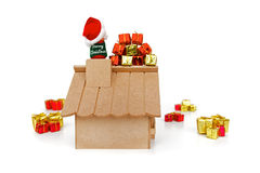 Back view - Santa Claus on roof and gifts. On white background royalty free stock photography