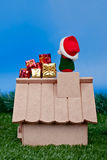 Back view - Santa Claus on roof and gifts. Santa on roof and gifts on studio shot royalty free stock photography