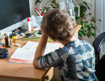 Back view of schoolchildren studying at home Royalty Free Stock Image