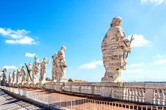 Back view of the sculptures of the twelve saints at the top of St. Peter`s basilica in Vatican. Back view of the sculptures of the twelve saints at the top of stock images