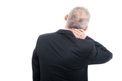 Back view of senior holding his neck like hurting Royalty Free Stock Photos