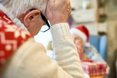 Lonely Senior People on Christmas royalty free stock photography
