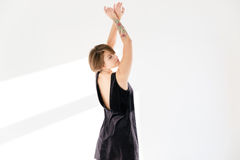 Back view of sensual attactive young woman with raised hands Royalty Free Stock Photography