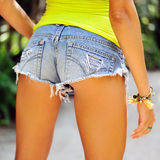 Back view of sexy young woman in denim shorts Stock Images