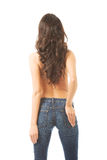 Back view shirtless woman touching her buttock.  royalty free stock image