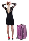 Back view of shocked business woman in dress traveling with suit Royalty Free Stock Photos