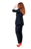 Back view of shocked business woman in suit. Royalty Free Stock Images