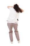 Back view of shocked in girl hid his eyes behind his hands. Royalty Free Stock Photo