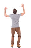 Back view of shocked  man in shirt .   upset young guy in jeans Royalty Free Stock Photography