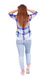 Back view of shocked redhead woman in jeans. Stock Images