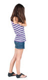Back view of shocked woman in blue jeans dress. Stock Images