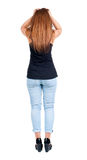 Back view of shocked woman in blue jeans. Royalty Free Stock Images
