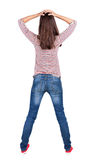 Back view of shocked woman in blue jeans. Stock Photography