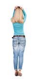 Back view of shocked woman in blue jeans. Royalty Free Stock Photos