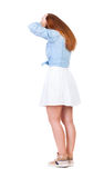 Back view of shocked woman in dress Royalty Free Stock Images