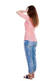 Back view of shocked woman. Royalty Free Stock Image