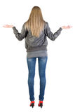 Back view of shocked  woman in gray jacket Royalty Free Stock Image