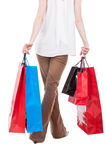 Back view of shopping woman carrying gift bags Royalty Free Stock Image