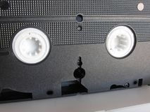 Back view of a single outdated videocassette . Old video tape Stock Images