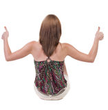 Back view of siting young blonde  woman showing thumb up. Stock Images