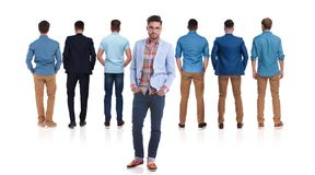 Back view of six men with team leader in front royalty free stock photography