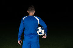 Back View Of Soccer Player On Black Background Stock Photography