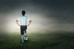 Back view of soccer player at field Stock Images