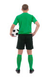 Back view of soccer player in green uniform isolated on white Royalty Free Stock Images