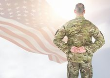 Back view of soldier in front of white background with american flag stock photo