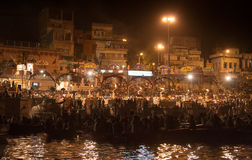 Back view of Spectators at the Night Puja. Ghats at the holy river of Ganga in Varanasi, Uttar Pradesh, India Royalty Free Stock Image