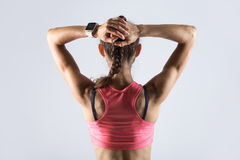 Back view of sporty girl with athletic body Royalty Free Stock Photo