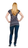 Back view of standing beautiful blonde woman. Royalty Free Stock Photography