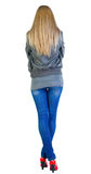 Back view of standing beautiful blonde woman. Stock Image