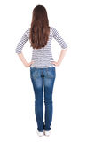 Back view of standing beautiful  brunette woman Stock Image