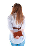 Back view of standing redhaired woman with  notebook looking Stock Photos