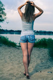 Back view of standing woman. Royalty Free Stock Image