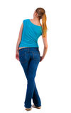 Back view of standing young beautiful  blonde woman Stock Photography