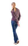 Back view of standing young beautiful  blonde woman Stock Images