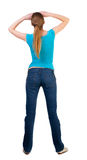 Back view of standing young beautiful  blonde woman Royalty Free Stock Images