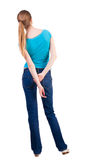 Back view of standing young beautiful  blonde woman Stock Image