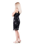 Back view of standing young beautiful  blonde woman. Stock Photography