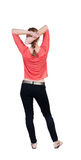 Back view of standing young beautiful  blonde woman in jeans. Royalty Free Stock Photography