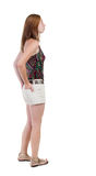 Back view of standing young beautiful  blonde woman in shorts Stock Photography
